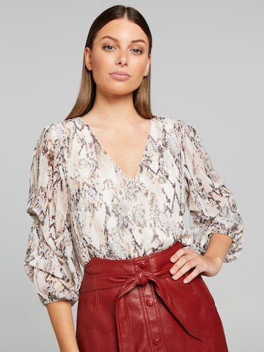 Retrograde Wrap Front Blouse